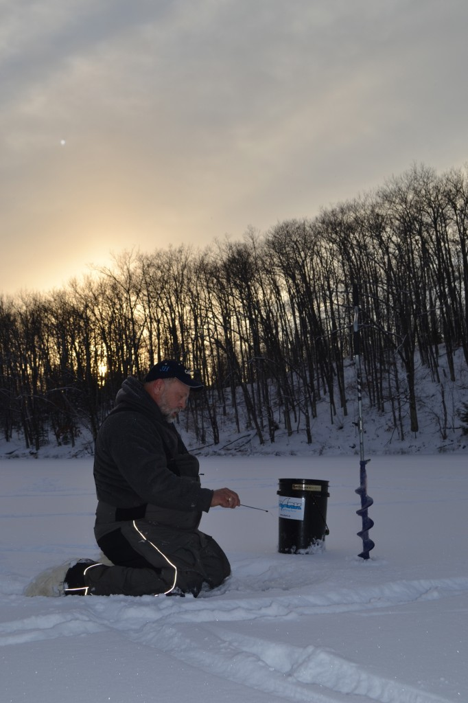 An angler offers ice fishing tips by showing how to find fish